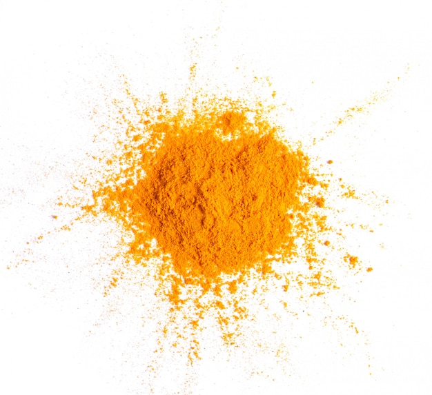 Turmeric (curcuma) powder pile isolated on white surface, top view