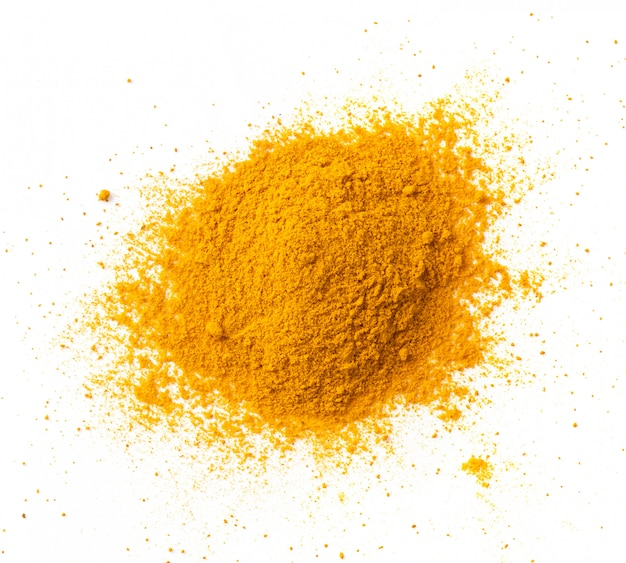Turmeric (curcuma) powder pile isolated on white, top view