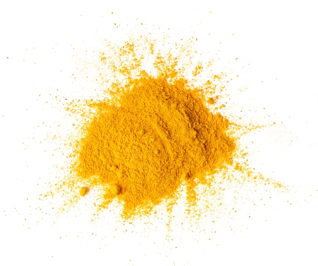 Turmeric (curcuma) powder pile on white, top view
