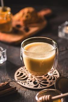 Turmeric latte on a dark background