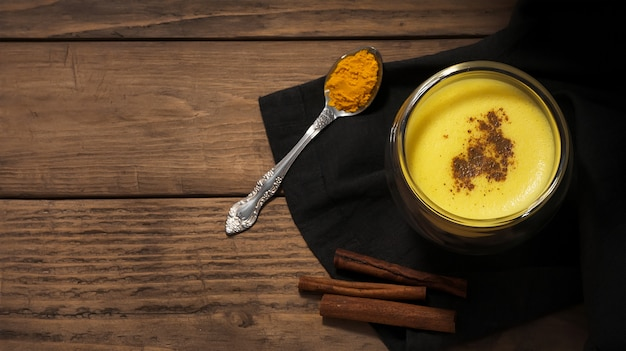 Turmeric milk with spice. healthy drink. top view