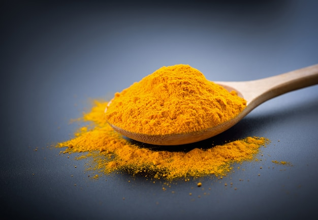 Turmeric powder on black.