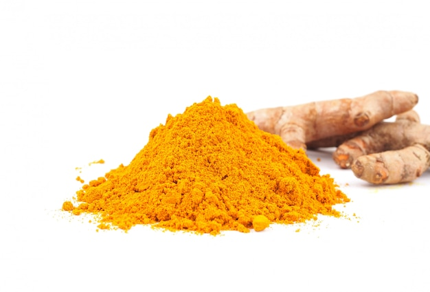 Turmeric powder (curcuma) on white background. herbal of nature