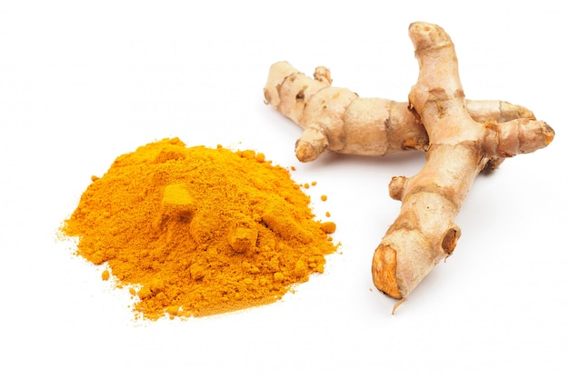 Turmeric powder and fresh turmeric onwhite background, herbal