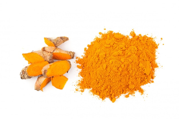 Turmeric powder and fresh turmeric on white background, herbs