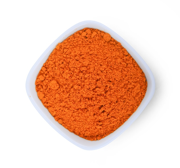Turmeric powder isolated on white surface.