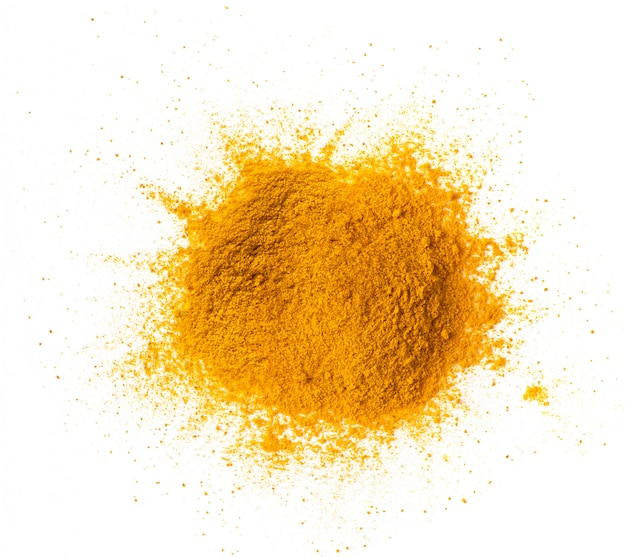 Turmeric powder pile isolated on white