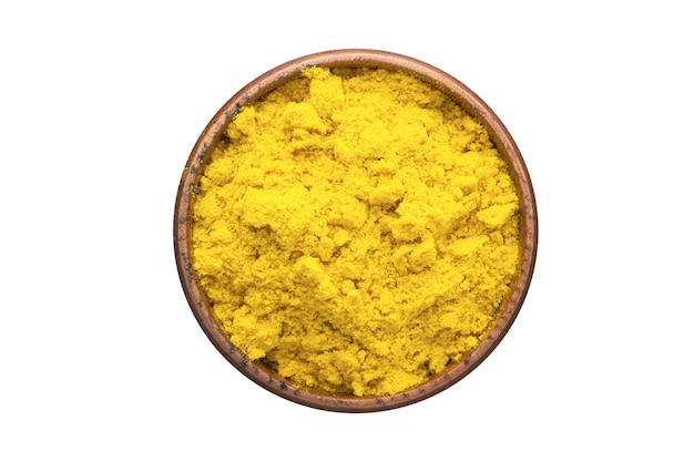 Turmeric powder spice in wooden bowl, isolated. seasoning top view
