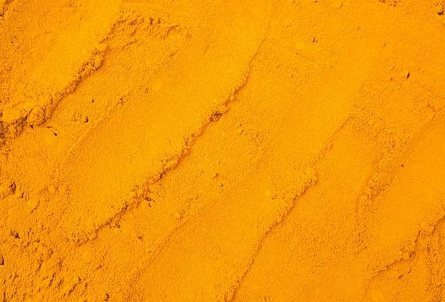 ウコン粉末テクスチャ、自然の背景。ハーブ系