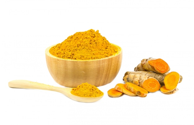 Turmeric powder and turmeric isolated on white background