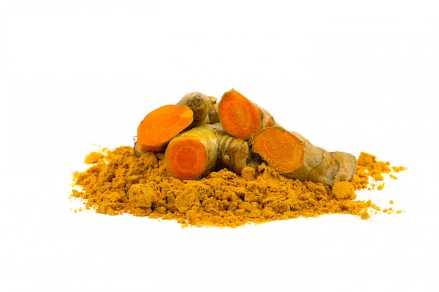 Turmeric powder and turmeric isolated on white