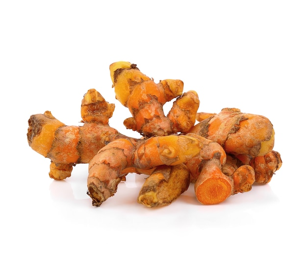 Turmeric root isolated on white background.
