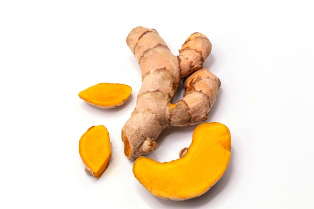 Turmeric root with slices isolate