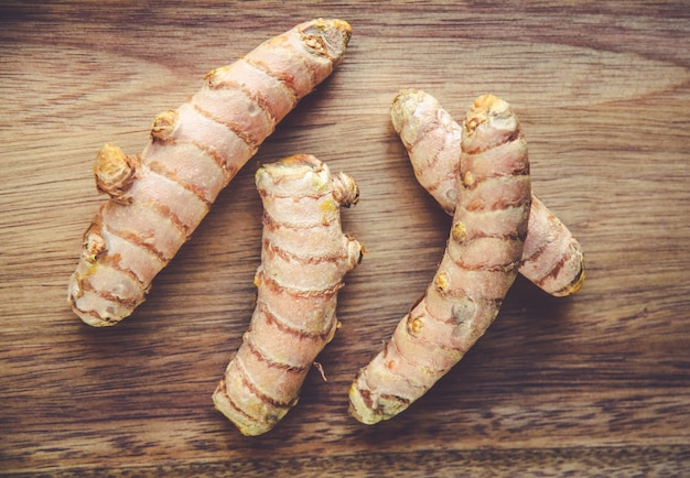 Turmeric root on a wooden cutting board
