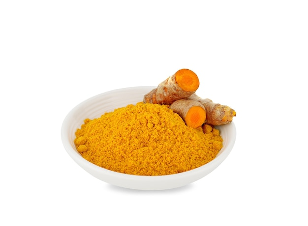 Turmeric roots with turmeric powder on white background,used for cooking and as herbal medicine