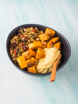Turmeric yogurt bowl with persimmon and granola
