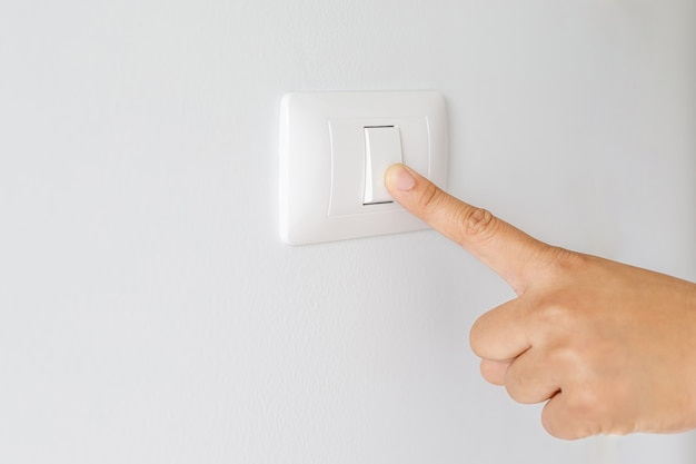 Turn on-off the light switch to save electricity.