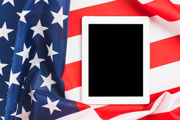 Turned off tablet on us flag