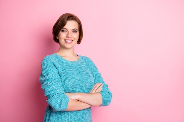 Turned photo portrait of pretty confident with toothy beaming smile lady wearing knitted pullover