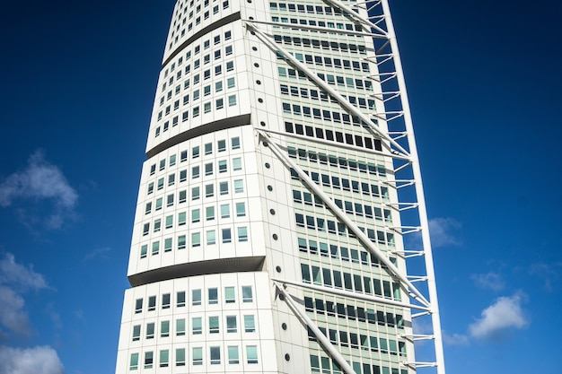 Turning torso under a blue sky and sunlight during daytime in malmo in sweden