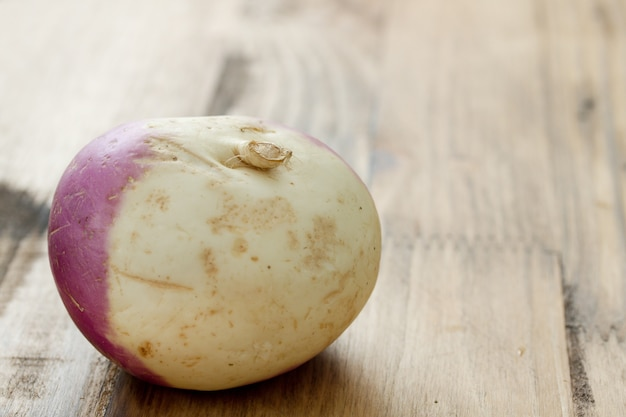 Turnip on brown wooden table