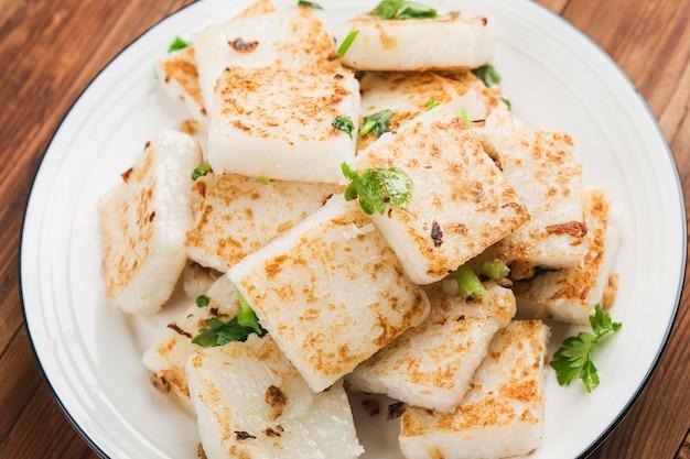 Turnip cake and xo sauce stir fried with tearadish cake, turnip cake,