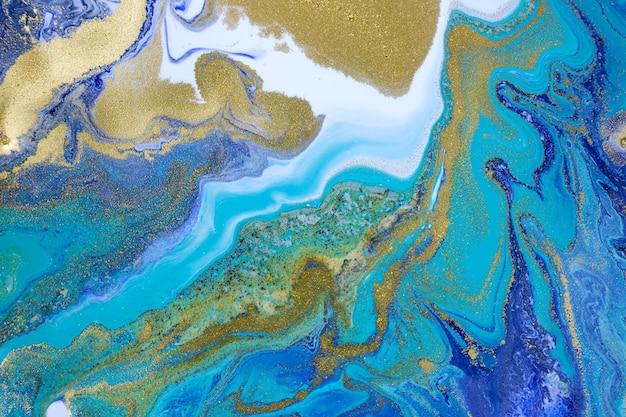 Бирюзовый абстрактный фон. темно-синий узор жидкими чернилами.