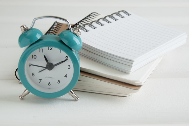 Turquoise alarm clock on white