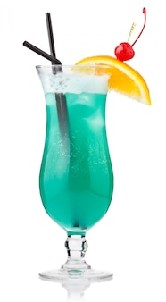Turquoise alcohol cocktail with berries and orange slice isolated