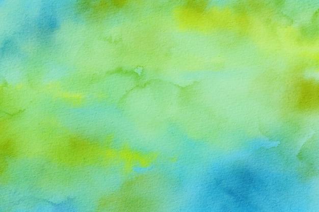 ターコイズと黄色の水彩背景紙のテクスチャ