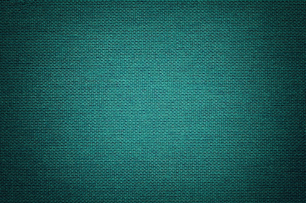 Turquoise background from a textile material with wicker pattern, closeup.