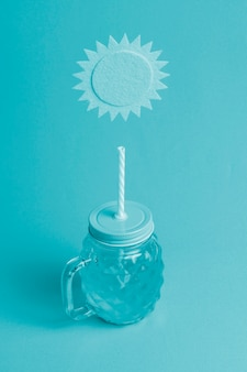 Turquoise background with drinking jar