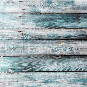 縦板が付いたターコイズブルーの古いヴィンテージウッド。グランジ木製の背景。