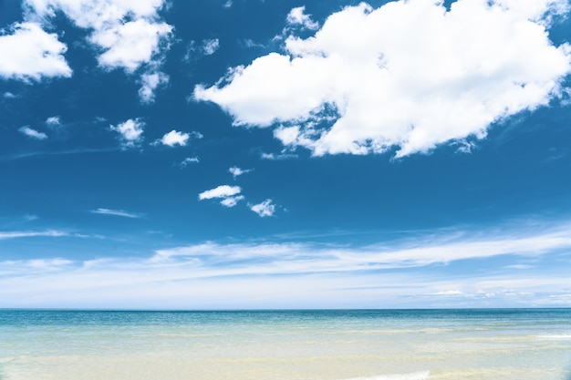 Turquoise blue sea with white sand and sunny sky