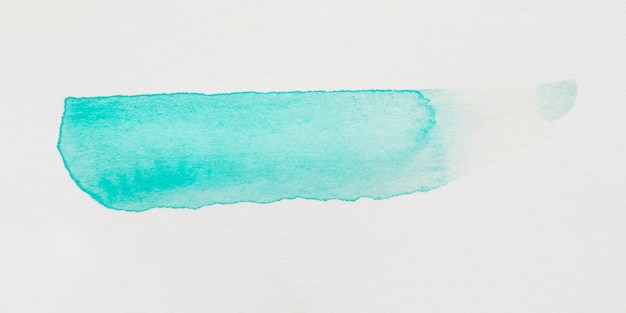 Бирюзовый мазок кисти на белом фоне
