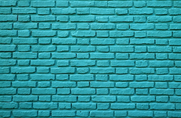 Turquoise colored brick wall at la boca in buenos aires of argentina for background, texture or pattern