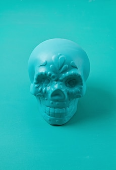 Turquoise decorative sugar skull. halloween decoration. skeleton head for the day of dead