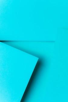 ターコイズブルーの幾何学的な紙の背景