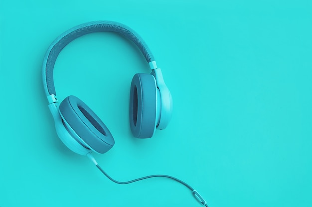 Turquoise headphones a colored background