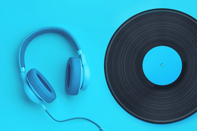 Turquoise  headphones with vinyl record on a colored background. music concept with copyspace. headphones on cyan background isolated