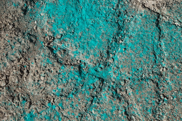 Turquoise holi color powder on ground