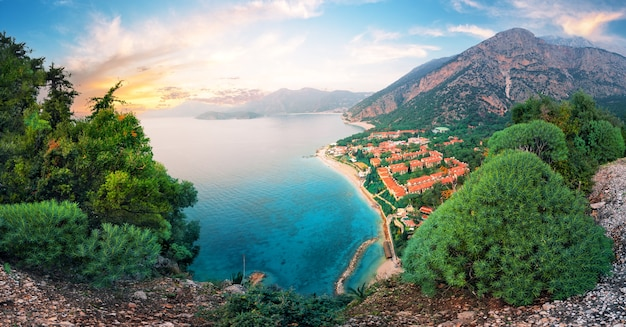 Turquoise lagoon with houses on the shore at sunset. panorama. oludeniz, turkey