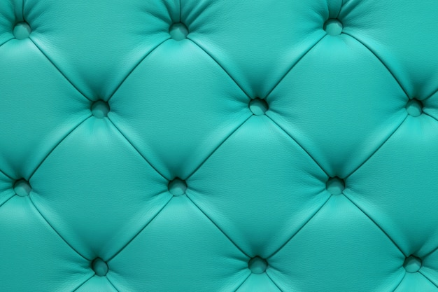 Turquoise leather sofa stitched buttons.