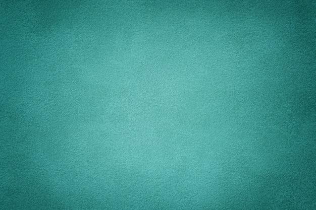 청록색 매트 스웨이드 직물 배경입니다. 벨벳 텍스처.