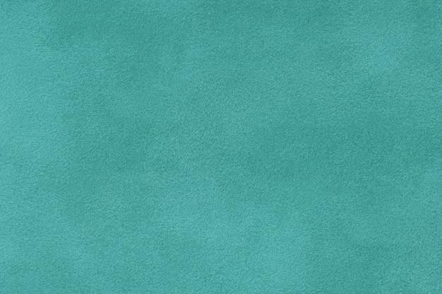Turquoise matt suede fabric closeup