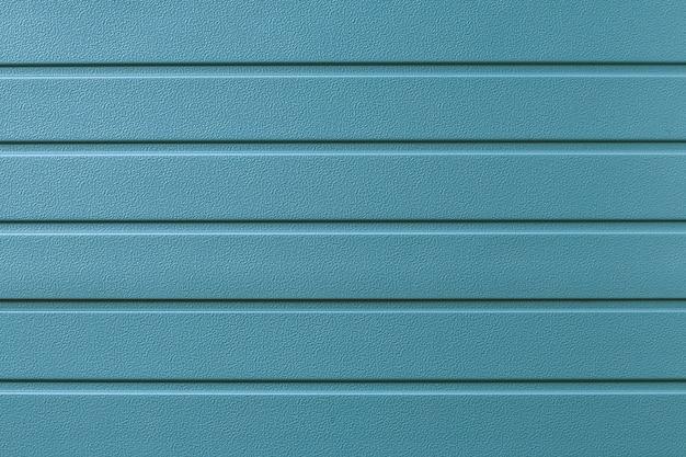 Turquoise metallic striped surface. metal wall siding, cladding.