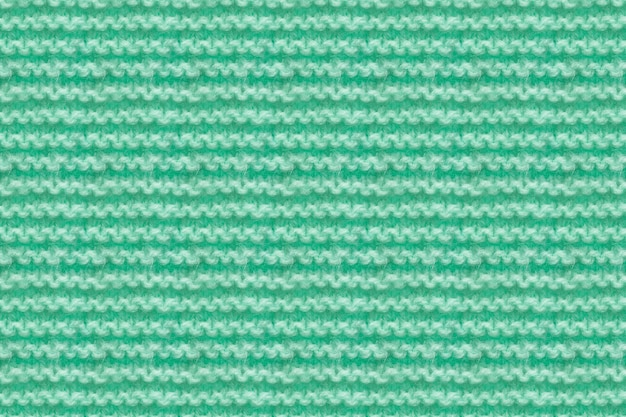 Turquoise, mint color knitwear fabric texture. knitting texture