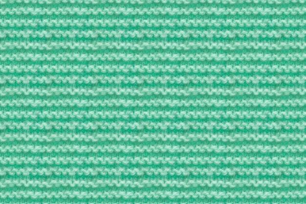 청록색, 민트 컬러 니트 직물 질감. 뜨개질 텍스처