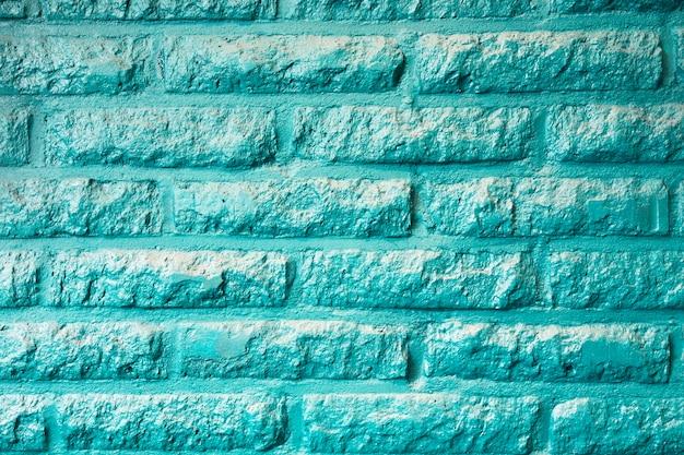 청록색 또는 아쿠아 민트 녹색 벽돌 벽 배경 질감 현대적인 desing. 레트로 파스텔 컬러 추상 스타일의 아름다움