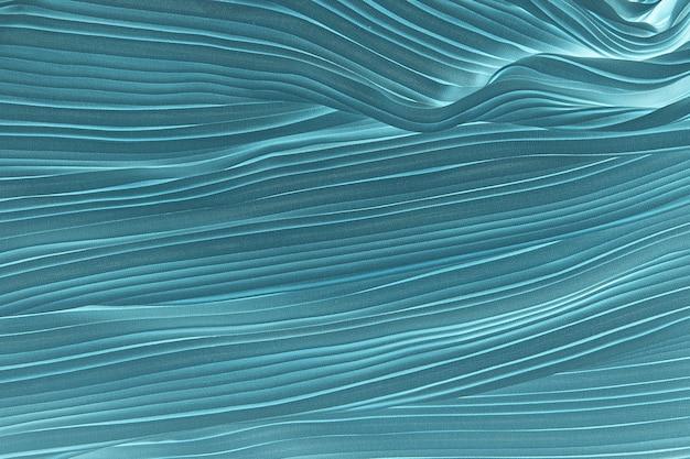 Turquoise plisse fabric background texture.